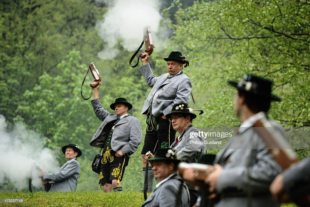 Marksmen in traditional Bavarian folk dress with salute guns fire their salute during the annual Ascension Mass (in German called Christi Himmelfahrt) at the open-air altar at Birkenstein on May 14, 2015 near Fischbachau, Germany. Several thousand pilgrims from 40 different folk group associations participated in the annual event to mark Jesus Christ's ascension to Heaven in a tradition going back centuries. Bavaria is predominantly Catholic.