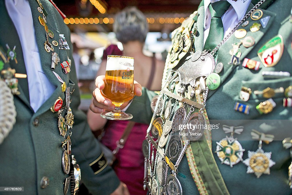 Marksmen with many medals drink traditional beer at the world's largest shooting fair, known as Schutzenfest, on July 6, 2014 in Hanover, Germany. A Schutzenfest, or German 'Marksmen's Festival' is a traditional festival featuring a target shooting competition in the cultures of both Germany and Switzerland. Reports indicate that more than a million visitors are expected to attend the 2014 Marksmen's Festival.