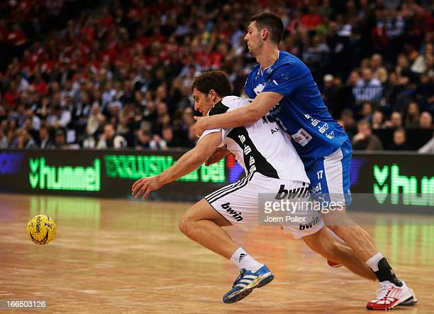 Markus Ahlm of Kiel challenged by Felix Danner of Melsungen during the Lufthansa Final Four SemiFinal between MT Melsungen and THW Kiel at O2 World...