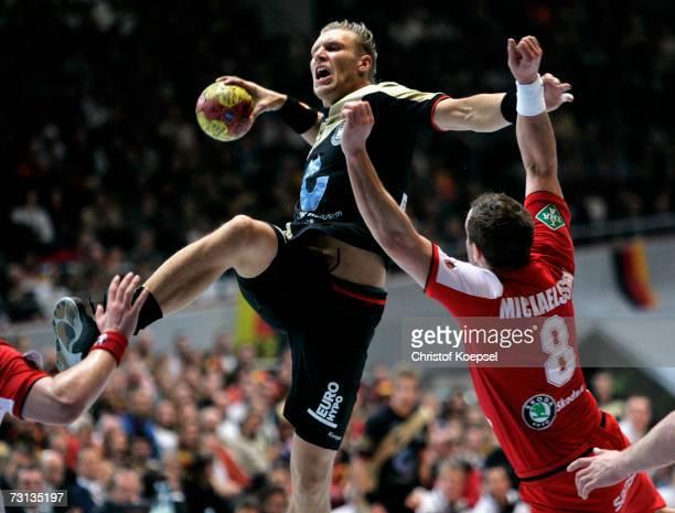 Markus Andreas Jakobsson of Iceland blocks the ball against Lars Kaufmann of Germany during the Men's Handball World Championship Group I game...