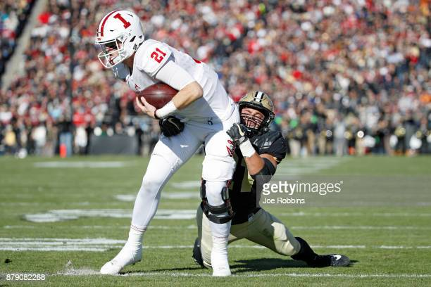 Markus Bailey of the Purdue Boilermakers tackles Richard Lagow of the Indiana Hoosiers in the first quarter of a game at RossAde Stadium on November...