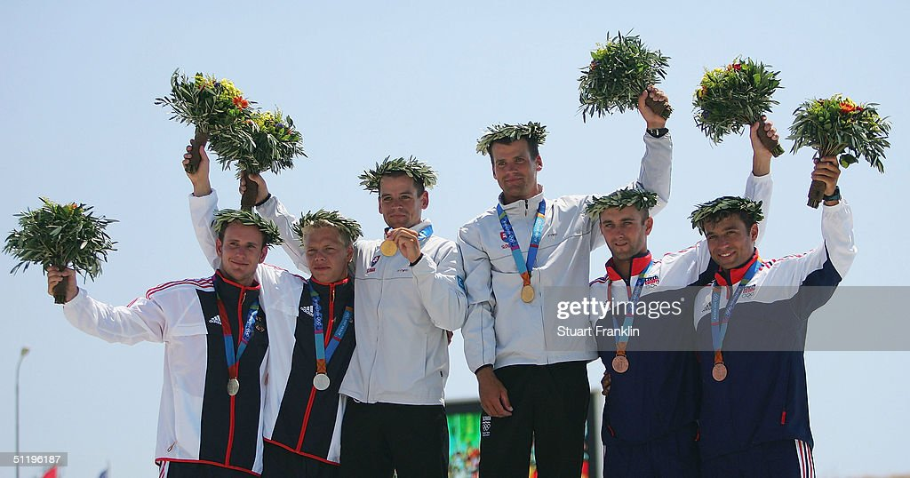 Markus Becker and Stefan Henze of Germany, Peter and Pavel Hochschorner of Slovakia and Jarosloav Volf and Ondres Stephanek of Czech receive their medals during ceremonies for the men's C-2 class slalom event on August 20, 2004 during the Athens 2004 Summer Olympic Games at the Schinias Olympic Slalom Centre in Athens, Greece.