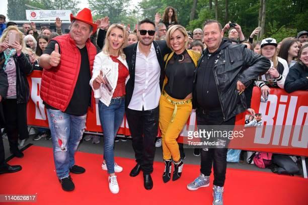 Markus Becker AnnaCarina Woitschack Menderes Bagci Willi Herren and his wife Jasmin Herren attend the Bild Race Day on May 1 2019 in Gelsenkirchen...