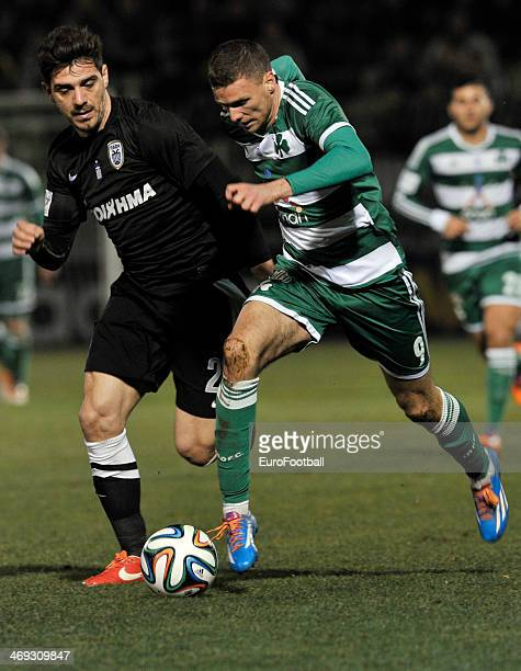 Markus Berg of Panathinaikos fights for the ball with Kostas Katsouranis of PAOK during the Greek Superleague between Panathinaikos and PAOK at the...