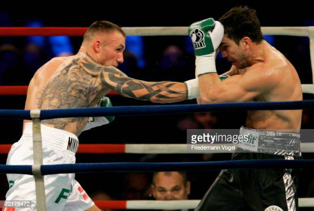 Markus Beyer of Germany and Mikkel Kessler of Denmark fight during the WBA and WBC World Supermiddleweight championship unification fight between...