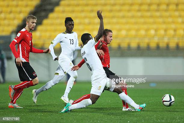 Markus Blutsch of Austria is tackled by Godfred Donsah of Ghana during the Group B FIFA U20 World Cup New Zealand 2015 match between Ghana and...