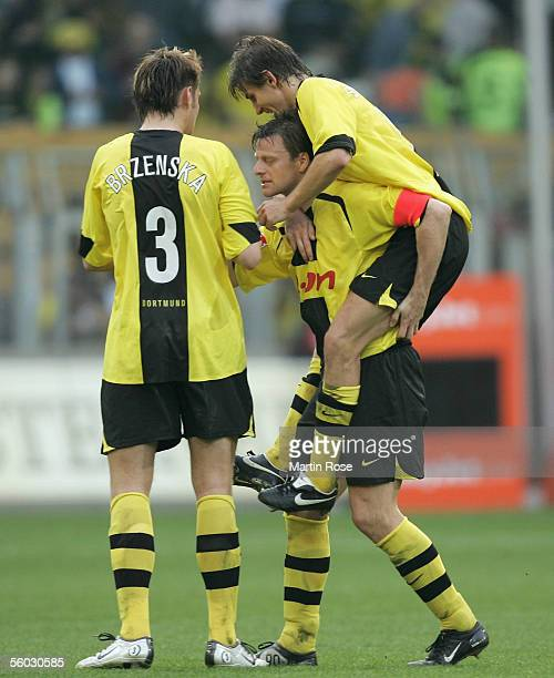 Markus Breska Christian Woerns and Ebi Smolarek of Dortmund celebrates winning after the Bundesliga match between Borussia Dortmund and Borussia...
