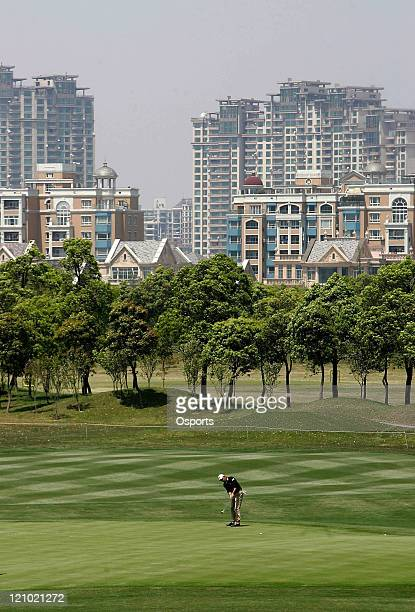 Markus Brier of Austria plays a shot on the 18th hole during the first round of the 2007 BMW Asian Open at the Tomson Shanghai Pudong Golf Club in...