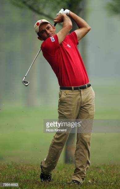 Markus Brier of Austria plays a shot on the par four 4th hole during the final round of the BMW Asian Open at the Tomson Shanghai Pudong Golf Club on...