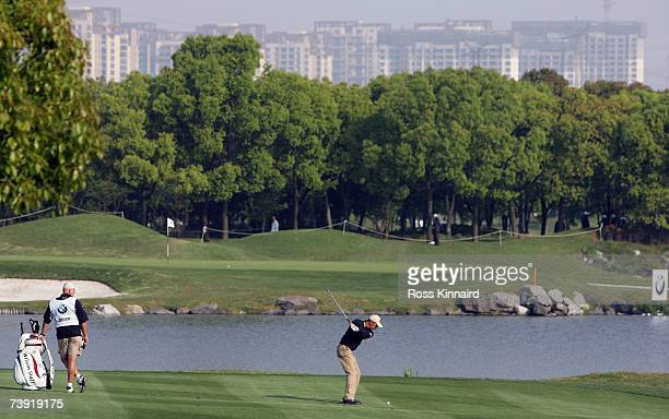 Markus Brier of Austria plays his second shot on the par four 11th hole during the first round of the BMW Asian Open at the Tomson Shanghai Pudong...