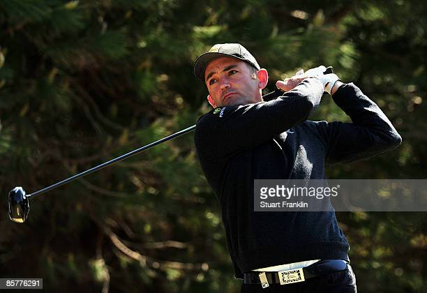 Markus Brier of Austria plays his tee shot on the fourth hole during the first round of The Estoril Open de Portugal The Oitavos Dunes Golf Course on...
