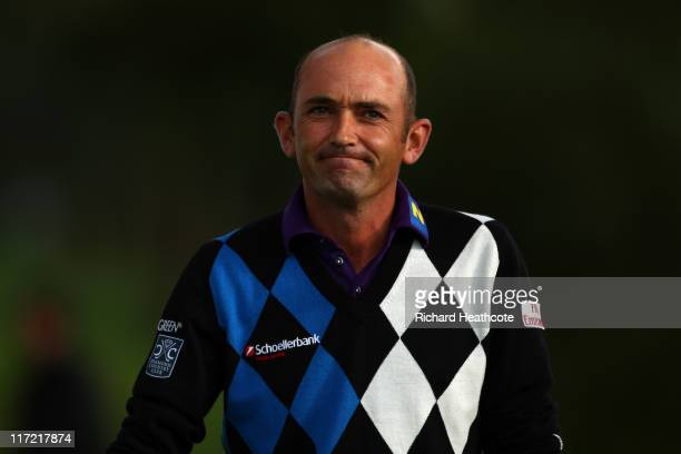 Markus Brier of Austria reacts to a putt on the 18th green during the second round of the BMW International Open at Golfclub Munchen Eichenried on...