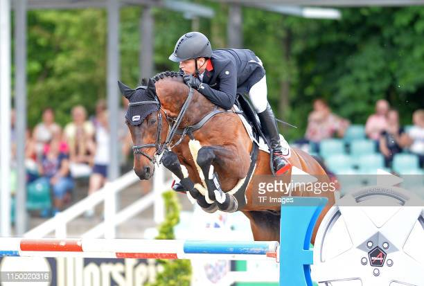 Markus Brinkmann jumps with Pikeur Dylon during the Longines Balve Optimum competition on June 14 2019 in Balve Germany