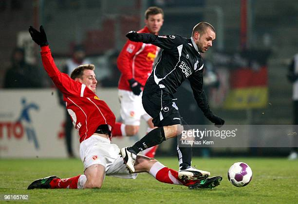 Markus Brzenska of Cottbus battles for the ball with Christian Tiffert of Duisburg during the Second Bundesliga match between FC Energie Cottbus and...