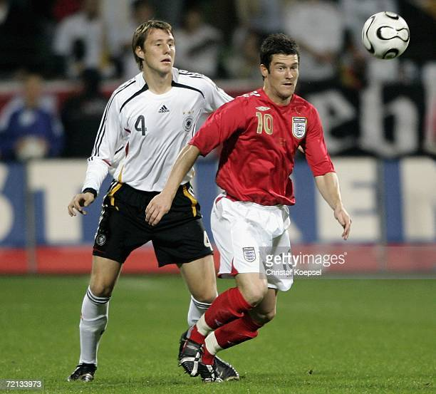 Markus Brzenska of Germany tackles David Nugent of England during the Men's European U21 Championship qualifying second leg game between Germany and...