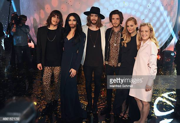 Markus Christ Conchita Wurst Dominic Muhrer Florian Meindl Mirjam Weichselbraun and Kathrin Zechner pose on stage during the Eurovision Song Contest...