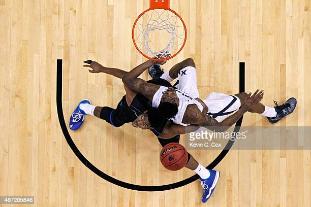 Markus Crider of the Georgia State Panthers and Jalen Reynolds of the Xavier Musketeers battle for a rebound during the third round of the 2015 NCAA...
