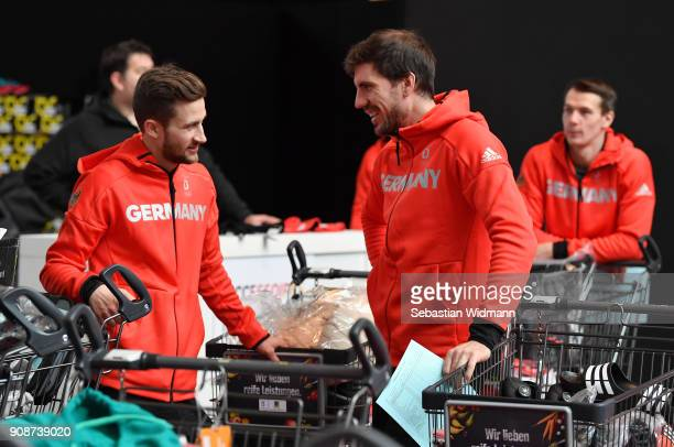 Markus Eisenbichler and Arnd Peiffer talk during the 2018 PyeongChang Olympic Games German Team kit handover at Postpalast on January 22 2018 in...