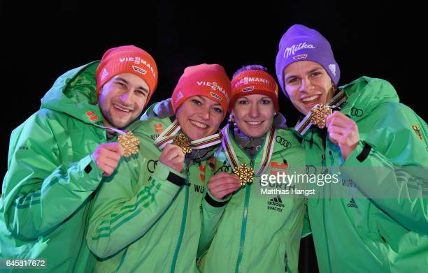 Markus Eisenbichler Carina Vogt Svenja Wuerth and Andreas Wellinger of Germany celebrate with their gold medals after victory in the Mixed Team HS100...
