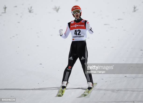 Markus Eisenbichler of Germany celebrates after his final jump in the Men's Ski Jumping HS100 Final during the FIS Nordic World Ski Championships on...