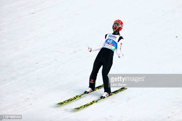 Markus Eisenbichler of Germany celebrates after his final round jump during the Ski Jumping Large Hill HS130 competition at Bergisel Schanze on...