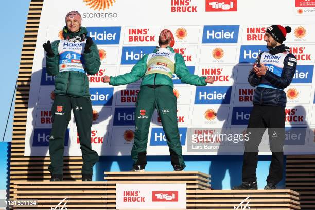 Markus Eisenbichler of Germany celebrates at the podium following his victory in the Ski Jumping Large Hill HS130 competition at Bergisel Schanze on...