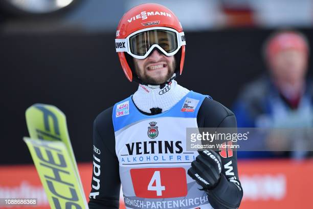 Markus Eisenbichler of Germany celebrates during the Final Round on day 4 of the 67th FIS Nordic World Cup Four Hills Tournament ski jumping event on...