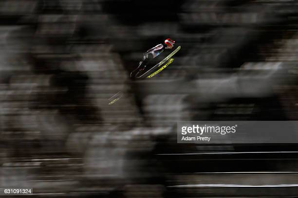 Markus Eisenbichler of Germany competes at the first round on Day 2 of the 65th Four Hills Tournament ski jumping event at PaulAusserleitnerSchanze...