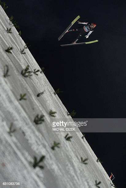 Markus Eisenbichler of Germany competes during the Four Hills competition of the FIS Ski Jumping World Cup in Bischofshofen on January 6 2017 / AFP /...