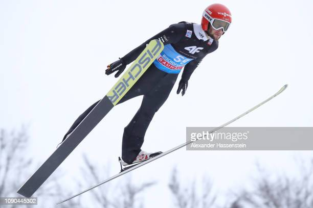 Markus Eisenbichler of Germany during the trial round on day 8 of the 67th FIS Nordic World Cup Four Hills Tournament ski jumping event at...