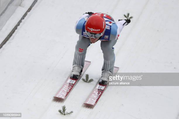 Markus Eisenbichler of Germany in action during the men's large hill competition at the Four Hills Tournament of the FISSki Jumping World Cup in...
