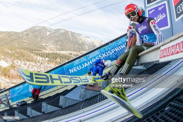 Markus Eisenbichler of Germany in action during the training run of the men's large hill ski jumping event at the Four Hills Tournament in...
