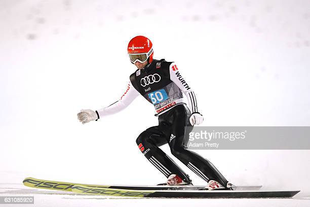 Markus Eisenbichler of Germany reacts after his final jump on Day 2 of the 65th Four Hills Tournament ski jumping event at PaulAusserleitnerSchanze...