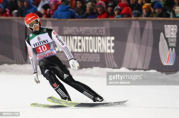 Markus Eisenbichler of Germany reacts after the second run of the men's large hill ski jumping event at the Four Hills Tournament in Oberstdorf...