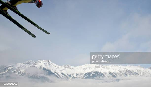 Markus Eisenbichler of Germany soars through the air during a training session for the third stage of the 63rd Four Hills Tournament ski jumping...