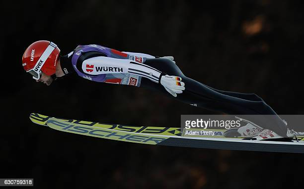 Markus Eisenbichler of Germany soars through the air during his first competition jump on Day 2 of the 65th Four Hills Tournament ski jumping event...