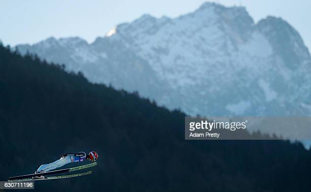 Markus Eisenbichler of Germany soars through the air during his training jump on Day 1 of the 65th Four Hills Tournament ski jumping event on...