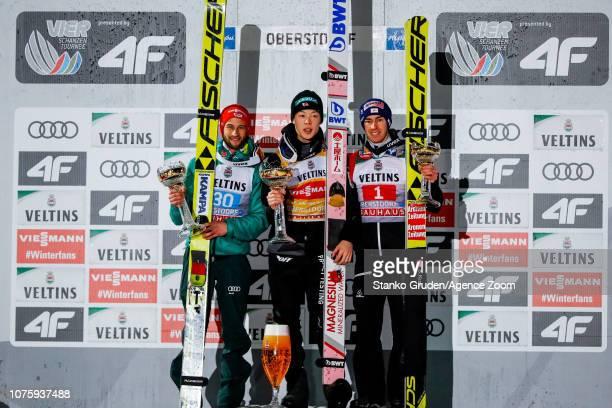 Markus Eisenbichler of Germany takes 2nd place Ryoyu Kobayashi takes 1st place Stefan Kraft of Austria takes 3rd place during the FIS Nordic World...