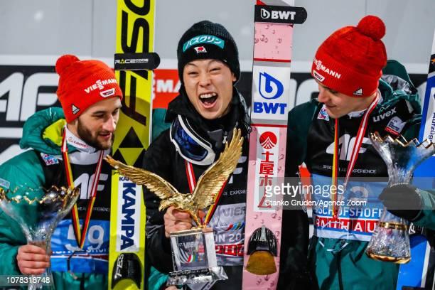 Markus Eisenbichler of Germany takes 2nd place Ryoyu Kobayashi takes 1st place Stephan Leyhe of Germany takes 3rd place during the FIS Nordic World...