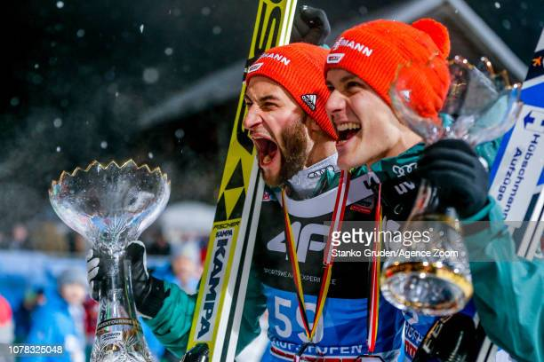 Markus Eisenbichler of Germany takes 2nd place Stephan Leyhe of Germany takes 3rd place during the FIS Nordic World Cup Four Hills Tournament on...