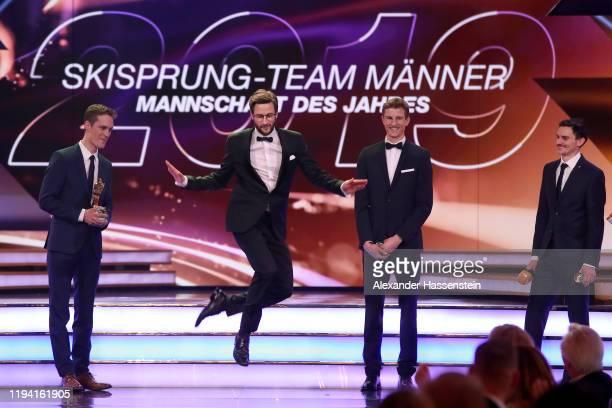 Markus Eisenbichler performes a traditional bavarian dance with team mates Stephan Leyhe , Karl Geiger and Richard Freitag of Team Skispringen as...