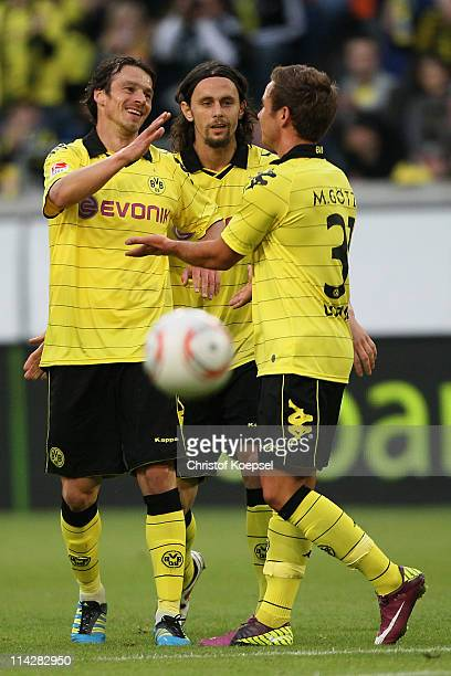 Markus Feulner celebrates the first goal with Neven Suboticv and Mario Goetze during the charity match between Borussia Dortmund and a Team of Japan...