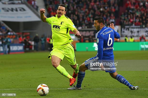 Markus Feulner of Augsburg battles for the ball with Sead Kolasinac of Schalke during the Bundesliga match between FC Augsburg and FC Schalke 04 at...