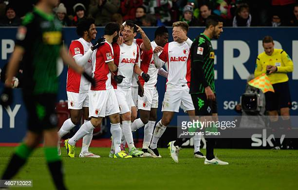 Markus Feulner of Augsburg celebrates with team mates after scoring his team's first goal during the Bundesliga match between FC Augsburg and...