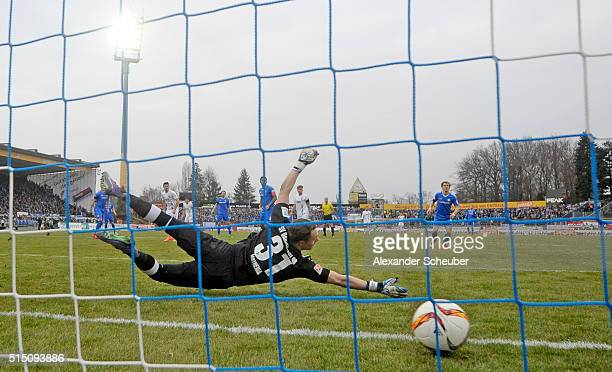 Markus Feulner of FC Augsburga scores the first goal for his team against Christian Mathenia of SV Darmstadt 98 during the first bundesliga match...