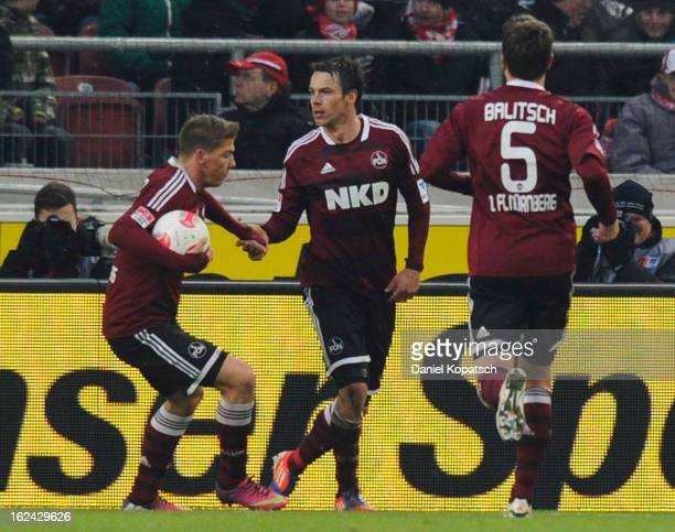 Markus Feulner of Nuernberg celebrates his team's first goal with team mates Mike Frantz and Hanno Balitsch during the Bundesliga match between VfB...