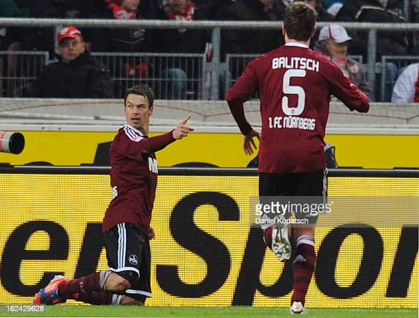 Markus Feulner of Nuernberg celebrates his team's first goal with team mate Hanno Balitsch during the Bundesliga match between VfB Stuttgart and 1 FC...