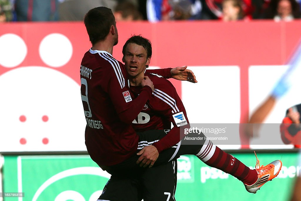 Markus Feulner (R) of Nuernberg celebrates scoring the opening goal with his team mate Tomas Pekhart during the Bundesliga match between 1. FC Nuernberg and FC Schalke 04 at Grundig-Stadion on March 16, 2013 in Nuremberg, Germany.
