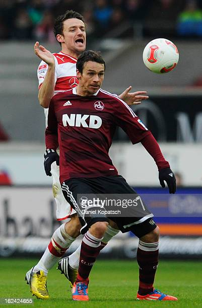 Markus Feulner of Nuernberg is challenged by Christian Gentner of Stuttgart during the Bundesliga match between VfB Stuttgart and 1 FC Nuernberg at...