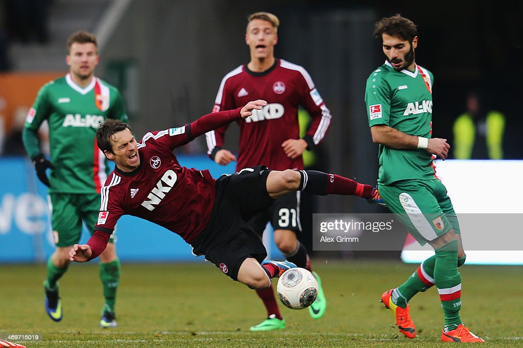 Markus Feulner (L) of Nuernberg is challenged by Halil Altintop of Augsburg during the Bundesliga match between FC Augsburg and 1. FC Nuernberg at SGL Arena on February 16, 2014 in Augsburg, Germany.